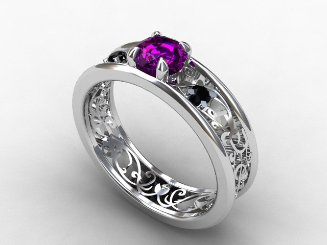 : gothic engagement and wedding rings