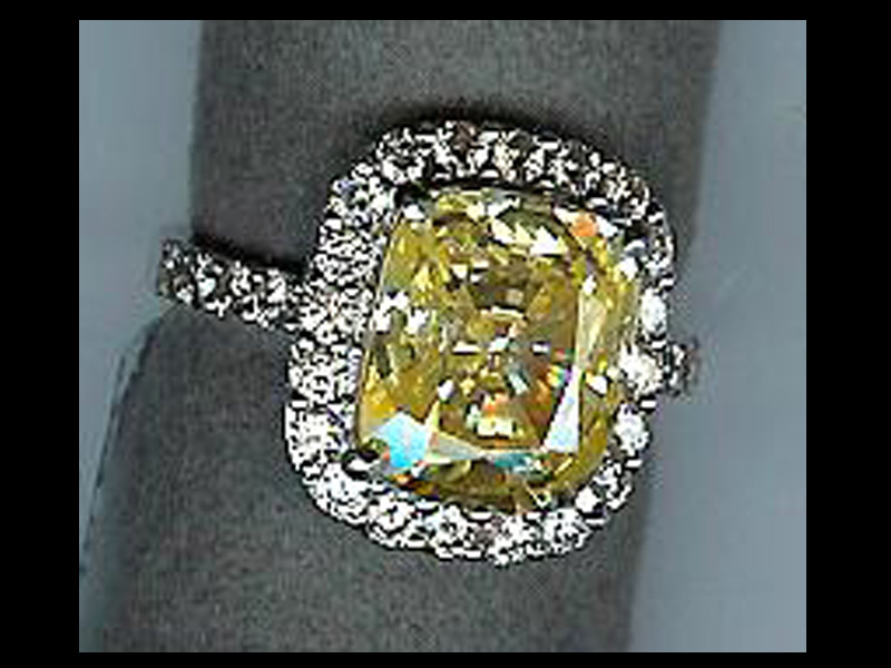 : round canary diamond engagement rings
